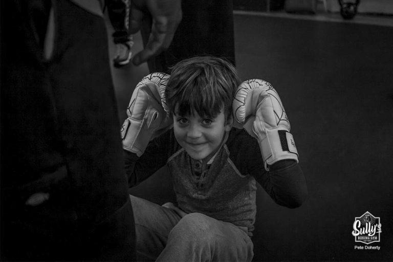 kid boxer doing sit ups