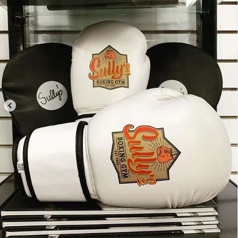 sully logo on white boxing gloves