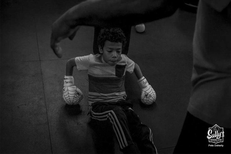 youth boxer taking a break