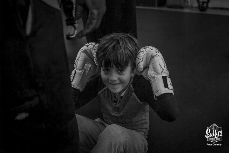 kid boxer doing sit ups
