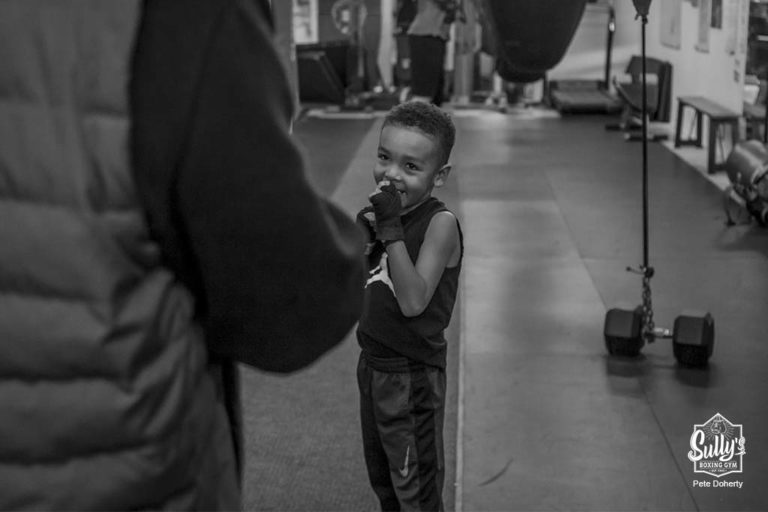 happy child at sullys boxing gym in toronto