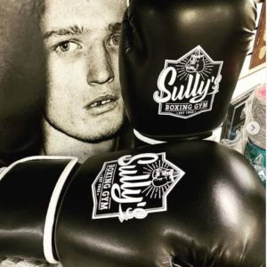 sully's logo on black boxing gloves